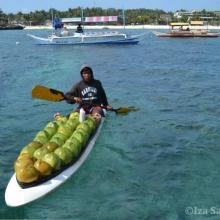 A coconut vendor at Crocodile Island